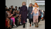 Legendary designer Vivienne Westwood parades Assange T-shirt for Fashion Week