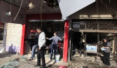 Militant assault on Iraq ministry building kills 18